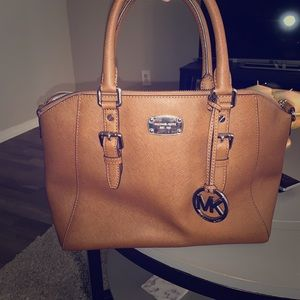 Brown Michael Kors purse.